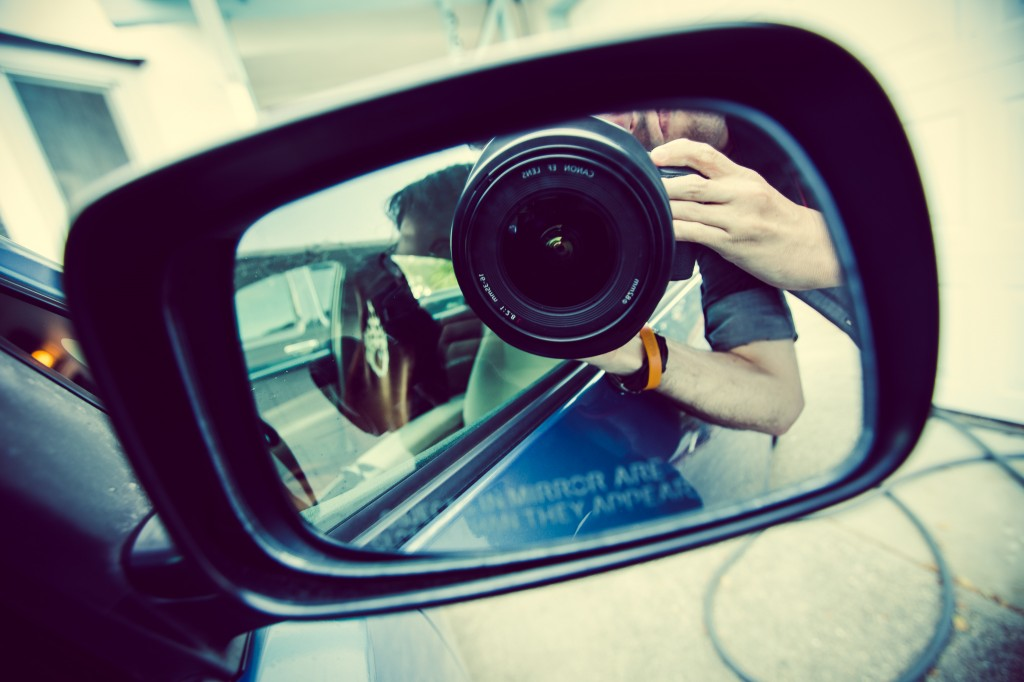 photo of camera looking at car side mirror
