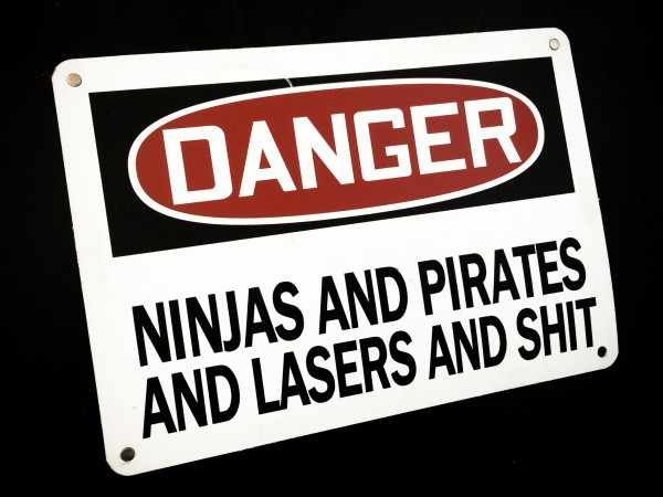 "Sign that says, ""Danger: Ninjas and pirates and lasers and shit"