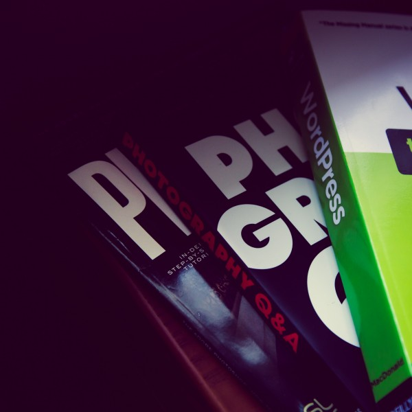 Shot of my current reading list. Just about done with WordPress: the Missing Manual. Then it'll be on to Zack Arias' Photography Q & A. Plus, there's always an issue of Photoshop User Magazine around.