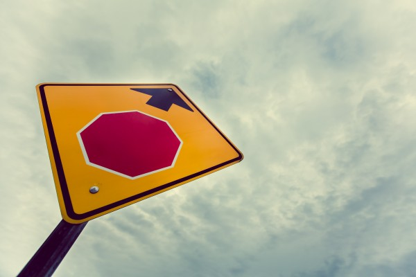 stop ahead sign pointing to sky